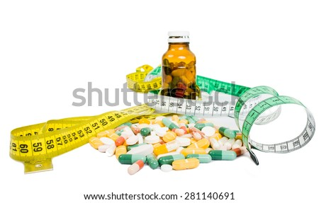 Weight loss using pills concept witj meter and bottle of tablets