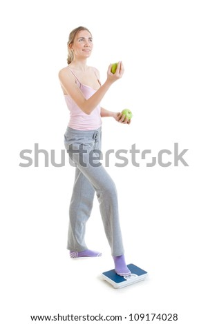 Weight loss woman on scales juggles apples