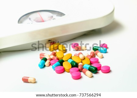 Weight Scale And drugs to lose weight .Conception about health care, selective focus