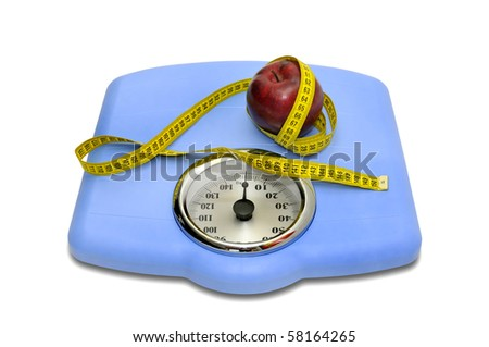 Weight scale with measuring tape and apple