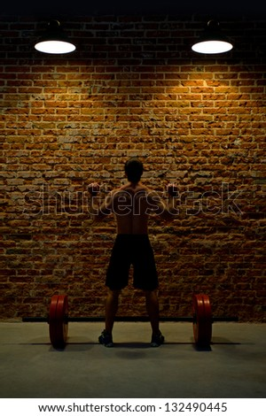 Weightlifting in a Dark Grunge Gym