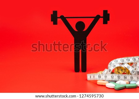 weightlifting pictogram with pills and tape measure, red background #1274595730