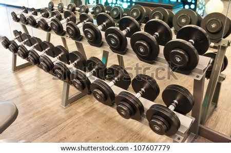 Weights,  many black dumbbell in fitness room