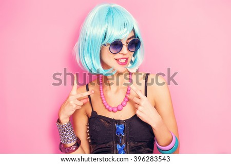 Weird and funny pop girl portrait wearing blue wig