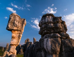 Weird rock formations of limestone at Ring itinerary in The Stone Forest located in Shilin Yi Autonomous County of Yunnan Province in China, Asia, UNESCO World Heritage Site