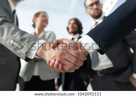 welcome and handshake business people - Shutterstock ID 1042092151