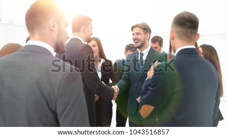 welcome and handshake of business partners in the office. - Shutterstock ID 1043516857