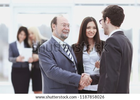 welcome and handshake of business people in the office.
