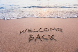 welcome back, text on sand beach, tourism after pandemic concept