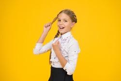Welcome back to school. Small schoolgirl with happy smile. Little schoolgirl looking nice in school uniform. Cute schoolgirl with long hair. Graduation concept. Primary education. Perfect schoolgirl