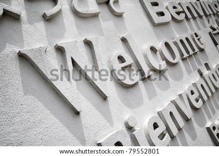 Welcome board with greeting in different languages - stock photo
