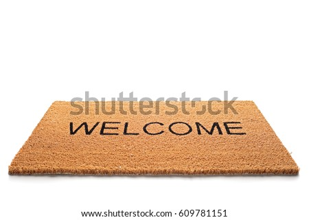 Welcome doormat isolated on white background - Shutterstock ID 609781151