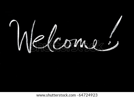 welcome handwritten in script in chalk on a blackboard