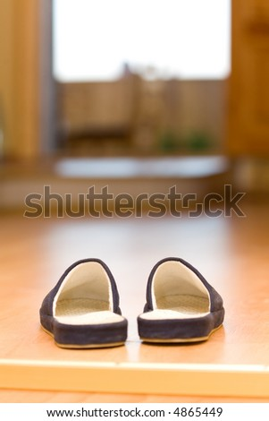 Welcome home! Slippers under entrance to porch - stock photo