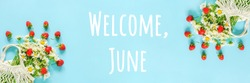 Welcome June text. Bouquet of white chamomile in reusable shopping eco mesh bag and splash red strawberries on blue background. Concept Hello summer. Banner Top view.