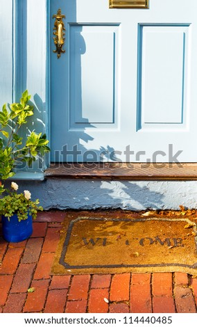 Welcome Mat Outside The Front Door Of A Vintage Cottage