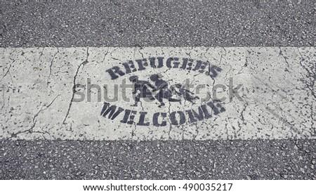 Welcome refugees roadside sign, symbol #490035217