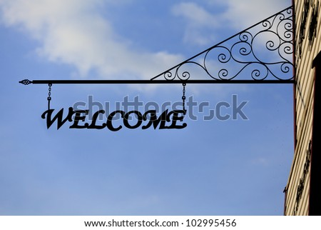 Welcome sign and blue sky in sunny day