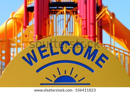 Welcome sign at a park playground