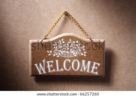 Welcome sign hung on background. - stock photo