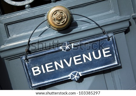 Welcome sign on a door of a French hotel
