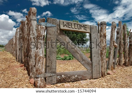 Welcome sign on the gate of rustic fence, Arizona, USA.