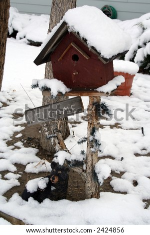 Welcome sign with bird house under first snow. #2424856