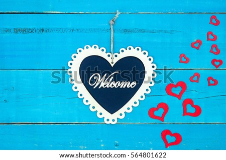 Welcome Slate And White Wood Lace Heart Sign Hanging From Rope With Cascading Red Hearts On