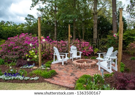 Welcome Spring and Summer with gardens designed for entertaining. Landscaped home design, small fairy gardens, painters get inspiration among the flowers. #1363500167