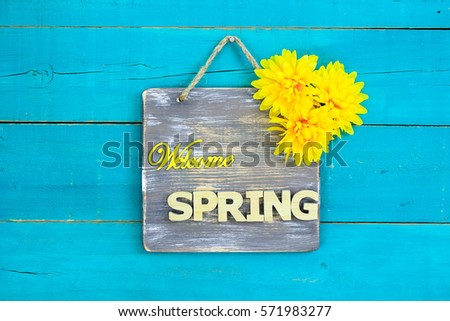 welcome spring sign with yellow ...