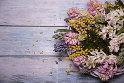welcome spring with spring flowers on a wooden table