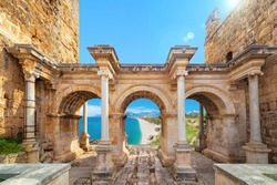 Welcome to amazing Antalya concept. Collage of famous landmarks: Hadrian's Gate old town Kaleici district and Konyaalti beach in popular resort city Antalya, Turkey