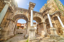 Welcome to Antalya concept. Hadrian's Gate is famous landmarks located in old town Kaleici district in popular resort city Antalya, Turkey