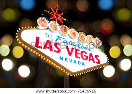 Welcome to Las Vegas Sign with bokeh of light in the background - stock photo