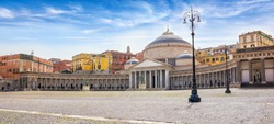 Welcome to Naples concept image. Daylight view of San Francesco di Paola church located at large public square Piazza del Plebiscito in Naples, Italy.