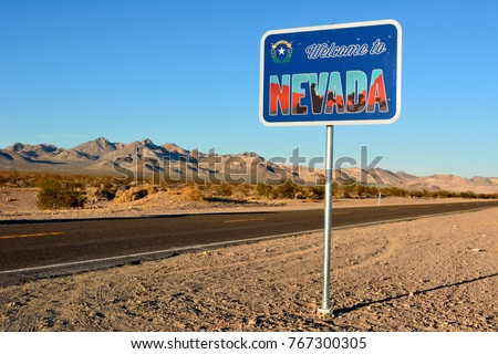 Welcome to Nevada road sign along a highway.