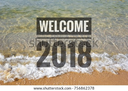 Welcome 2018 word written on the beach #756862378