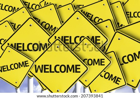 Welcome written on multiple road sign