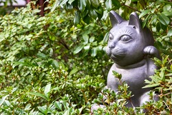 Welcoming cat sculpture in the garden
