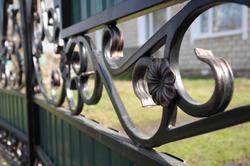 welded iron metal fence flower element detail closeup