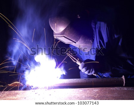 Welder and bright sparks. Construction and production