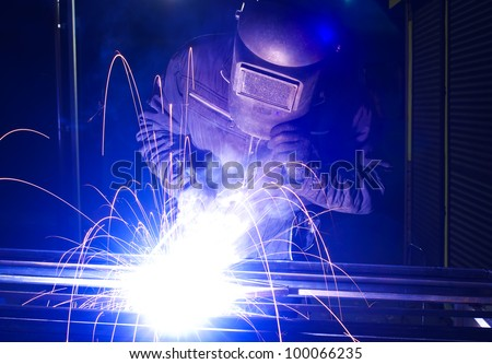 Welder and bright sparks. Production and construction
