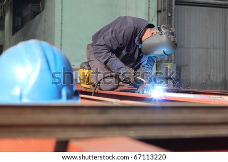 Welder at work in a Factory - stock photo