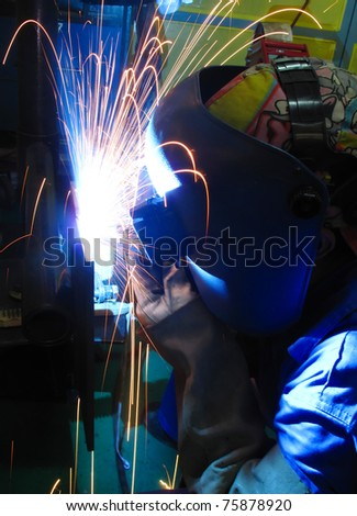 welder in action and fire sparks