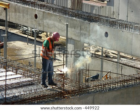 Welder welding building elements at the construction site