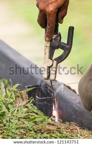 Welder welding  elements at the  construction site