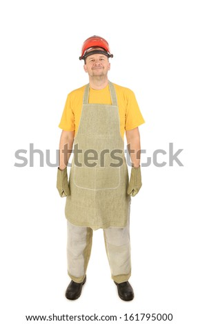 Welder with plastic protective face shield gloves and apron. Isolated on a white background.