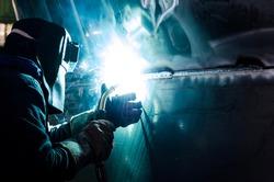 Welder worker doing aluminum welding