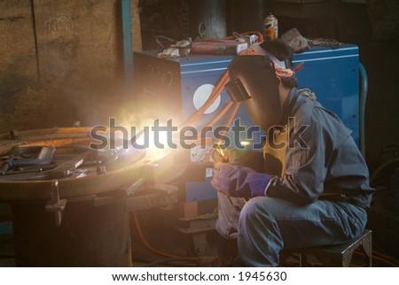 Welder working at a mechanical workshop