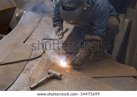 Welder Working Metal Plates